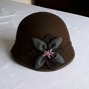 Brown felt hat with wool flower on the side